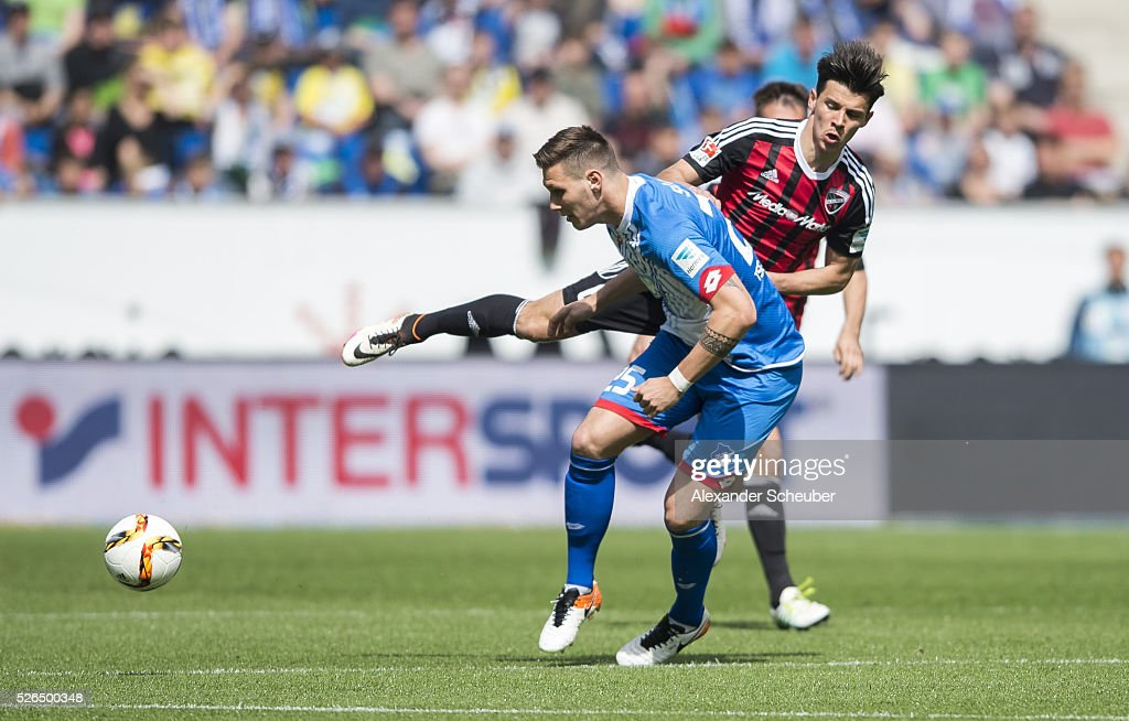 Niklas Suele of Hoffenheim challenges Alfredo Morales of FC Ingolstadt during the first bundesliga match between 1899 Hoffenheim and FC Ingolstadt at Wirsol Rhein-Neckar-Arena on April 30, 2016 in Sinsheim, Germany.