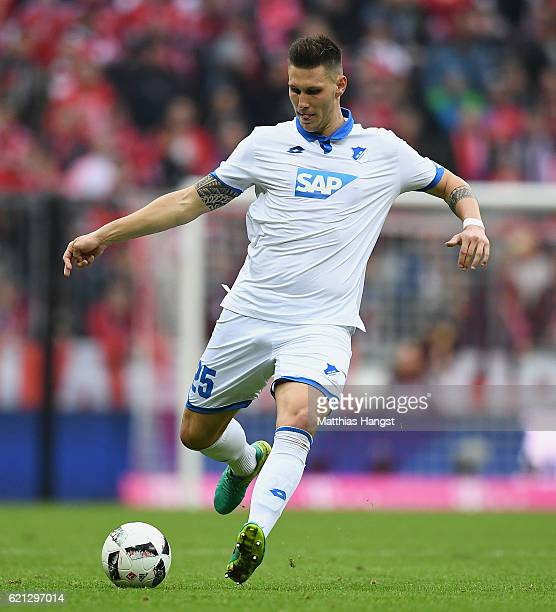 Niklas Suele of Hoffenheim controls the ball during the Bundesliga match between Bayern Muenchen and TSG 1899 Hoffenheim at Allianz Arena on November...