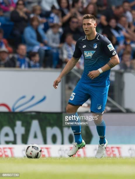 Niklas Suele of Hoffenheim controls the ball during the Bundesliga match between TSG 1899 Hoffenheim and FC Augsburg at Wirsol RheinNeckarArena on...