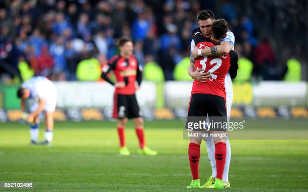 Niklas Suele of Hoffenheim hughs Vincenzo Grifo of Freiburg after the Bundesliga match between SC Freiburg and TSG 1899 Hoffenheim at...