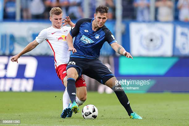 Niklas Suele of Hoffenheim is challenged by Timo Werner of Leipzig during the Bundesliga match between TSG 1899 Hoffenheim and RB Leipzig at Wirsol...