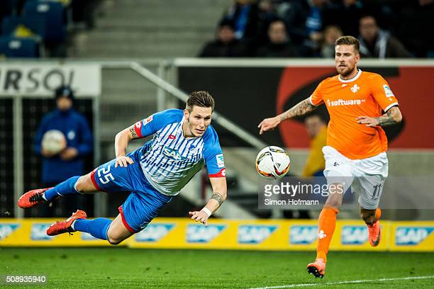 Niklas Suele of Hoffenheim jumps for a header with Tobias Kempe of Darmstadt during the Bundesliga match between 1899 Hoffenheim and SV Darmstadt 98...