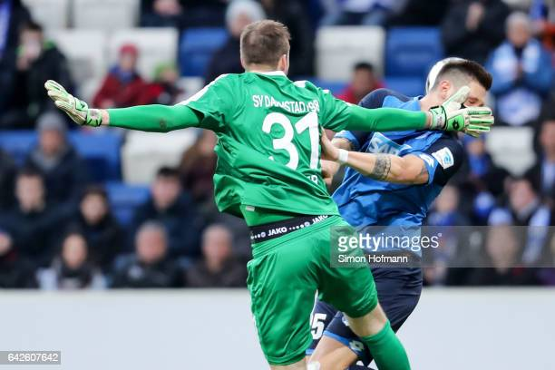 Niklas Suele of Hoffenheim tries to score against Michael Esser of Darmstadt during the Bundesliga match between TSG 1899 Hoffenheim and SV Darmstadt...