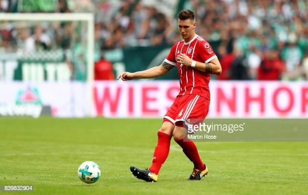Niklas Suele of Muenchen runs with the ball during the Bundesliga match between SV Werder Bremen and FC Bayern Muenchen at Weserstadion on August 26...