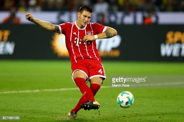 Niklas Suele of Muenchen runs with the ball during the DFL Supercup 2017 match between Borussia Dortmund and Bayern Muenchen at Signal Iduna Park on...