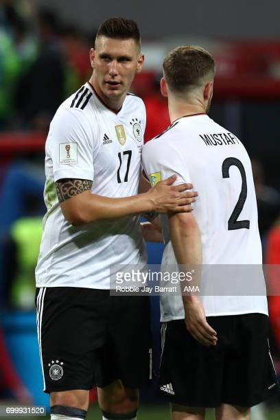 Niklas Sule of Germany reacts with teammate Shkodran Mustafi during the FIFA Confederations Cup Russia 2017 Group B match between Germany and Chile...