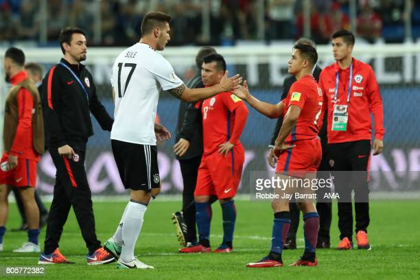 Niklas Sule of Germany shakes hands with Alexis Sanchez of Chile at the end of the FIFA Confederations Cup Russia 2017 Final match between Chile and...