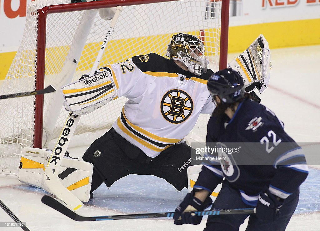 Niklas Svedberg #72 of the Boston Bruins makes a save after Chris Thorburn #22 of the Winnipeg Jets tries to fire the puck behind him in first period action during an NHL preseason game at the MTS Centre on September 26, 2013 in Winnipeg, Manitoba, Canada.