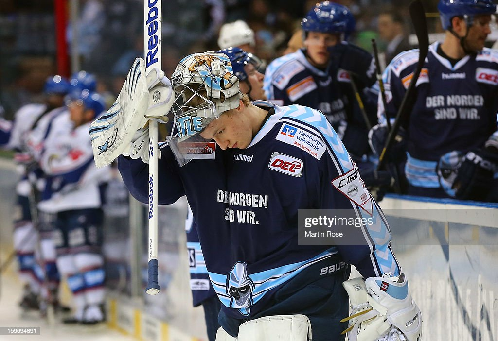 Niklas Treutle, goaltender of Hamburg looks dejeted during the DEL match between Hamburg Freezers and Adler Mannheim at O2 World on January 18, 2013 in Hamburg, Germany.