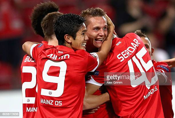 Niko Bungert of FSV Mainz 05 celebrates scoring the opener with teammates during the UEFA Europa League Group C match between 1 FSV Mainz 05 and AS...