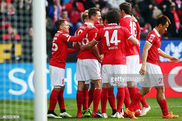 Niko Bungert of Mainz celebrates his team's first goal with team mates during the Bundesliga match between 1 FSV Mainz 05 and VfL Wolfsburg at Coface...