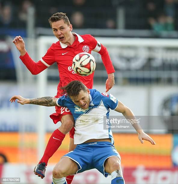 Niko Bungert of Mainz is challenged by Eugen Polanski of Hoffenheim during the Bundesliga match between 1899 Hoffenheim and 1 FSV Mainz 05 at Wirsol...