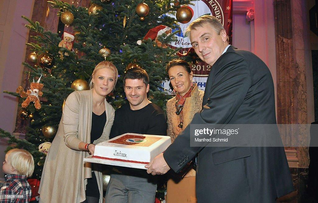 Niko Fechter, Ciro de Luca, Maya Hakvoort and Alexander Betanishvili attend the Christmas ball for children Energy For Life - Heat For Children's Hearts at Hofburg Vienna on December 11, 2012 in Vienna, Austria.