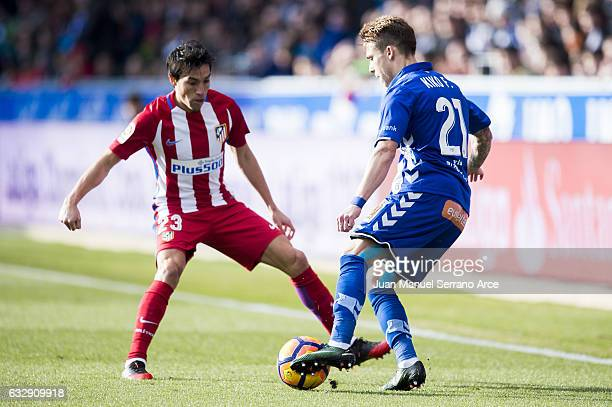 Niko Gaitan of Atletico Madrid duels for the ball with Francisco Femenia of Deportivo Alaves during the La Liga match between Deportivo Alaves and...