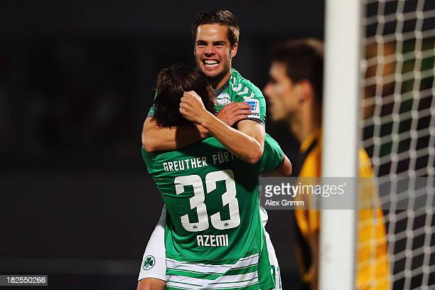 Niko Giesselmann of Greuther Fuerth celebrates his team's third goal with team mate Ilir Azemi during the Bundesliga match between SpVgg Greuther...