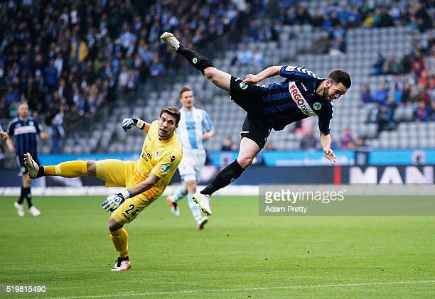 Niko Giesselmann of SpVgg Greuther Furth collides with Goalkeeper Stefan Ortega of TSV 1860 Munich during 2 Bundesliga match between 1860 Muenchen...