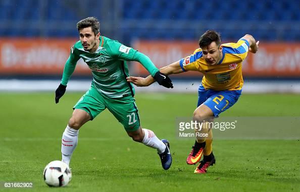 Niko Kijewski of Braunschweig and Fin Bartels of Bremen battle for the ball during the friendly match between Eintracht Braunschweig and Werder...
