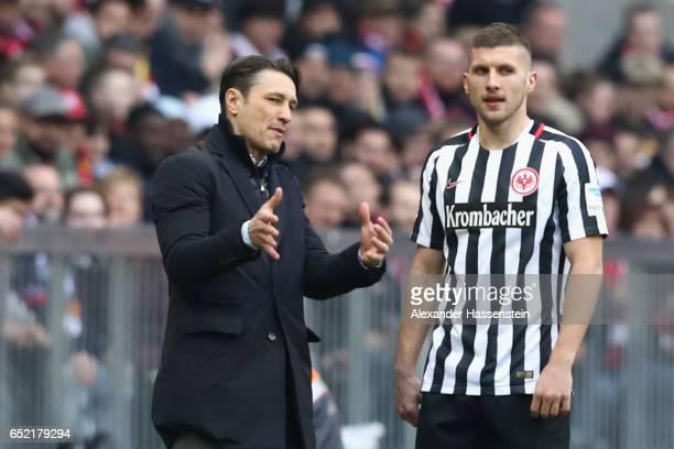 Niko Kovac head coach of Frankfurt talks to his player Ante Rebic during the Bundesliga match between Bayern Muenchen and Eintracht Frankfurt at...