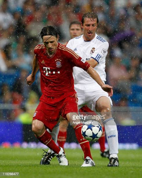 Niko Kovac of Bayern Muenchen duels for the ball with Luis Ramis of Real Madrid during the Corazon Classic Match between Allstars Real Madrid and...