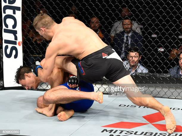 Niko Price punches Alan Jouban in their welterweight bout during the UFC Fight Night event at Arena Ciudad de Mexico on August 5 2017 in Mexico City...