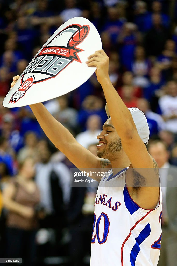 Niko Roberts #20 of the Kansas Jayhawks celebrates their 70-54 win over Kansas State Wildcats during the Final of the Big 12 basketball tournament at Sprint Center on March 16, 2013 in Kansas City, Missouri.