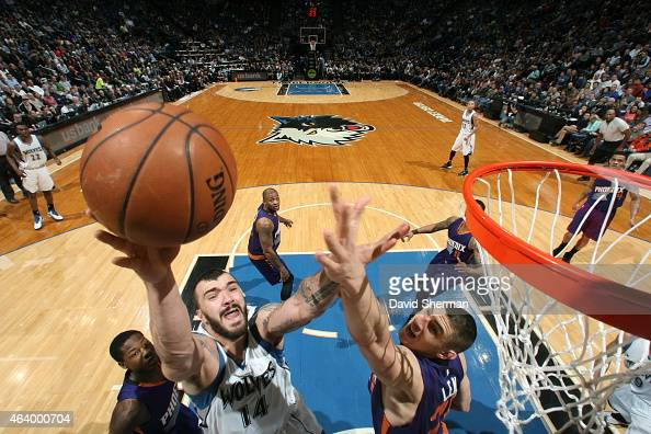Nikoa Pekovic of the Minnesota Timberwolves goes up for a shot against the Phoenix Suns during the game on February 20 2015 at Target Center in...