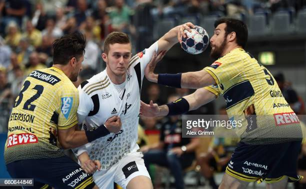 Nikola Bilyk of Kiel is challenged by Alexander Petersson and Gedeon Guardiola of RheinNeckar Loewen during the EHF Champions League Quarter Final...