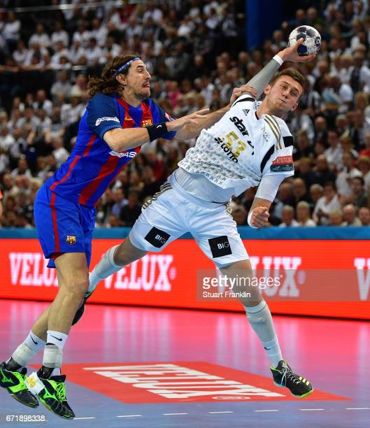 Nikola Bilyk of Kiel is challenged by Viran Morros De Argila of Barcelona during the EHF Champions League Quarter Final first leg match between THW...