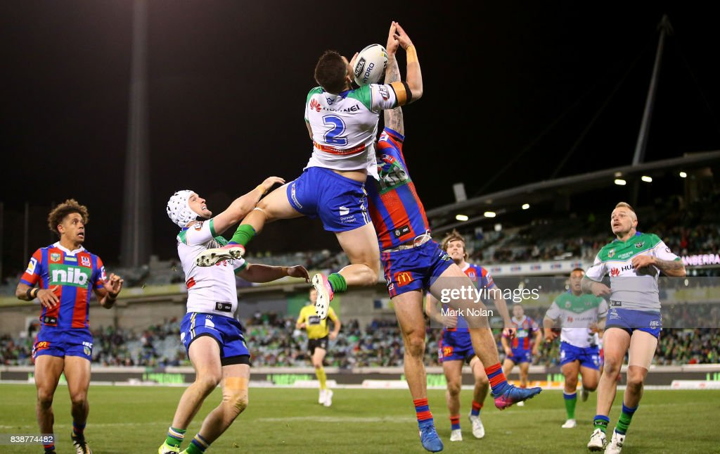 Nikola Cotric of the Raiders and Shaun Kenny-Dowall of the Knights contest a high ball during the round 25 NRL match between the Canberra Raiders and the Newcastle Knights at GIO Stadium on August 25, 2017 in Canberra, Australia.