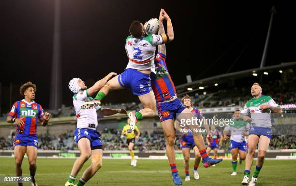 Nikola Cotric of the Raiders and Shaun KennyDowall of the Knights contest a high ball during the round 25 NRL match between the Canberra Raiders and...