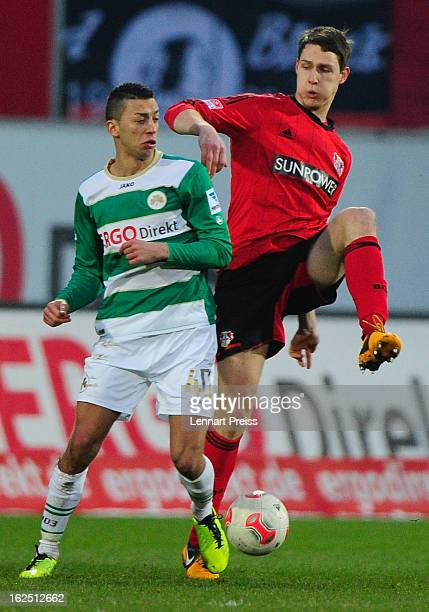 Nikola Djurdjic of Fuerth and Philipp Wollscheid of Leverkusen fight for the ball during the Bundesliga match between SpVgg Greuther Fuerth and Bayer...