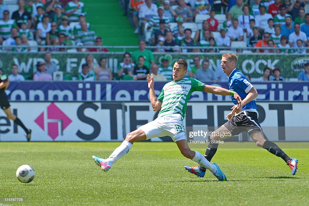 Nikola Djurdjic (L) of Fuerth scores his teams second goal against Marc Lorenz of Bielefeld during the Second Bundesliga match between Greuther Fuerth and Arminia Bielefeld at the Trolli Arena on July 21, 2013 in Fuerth, Germany.