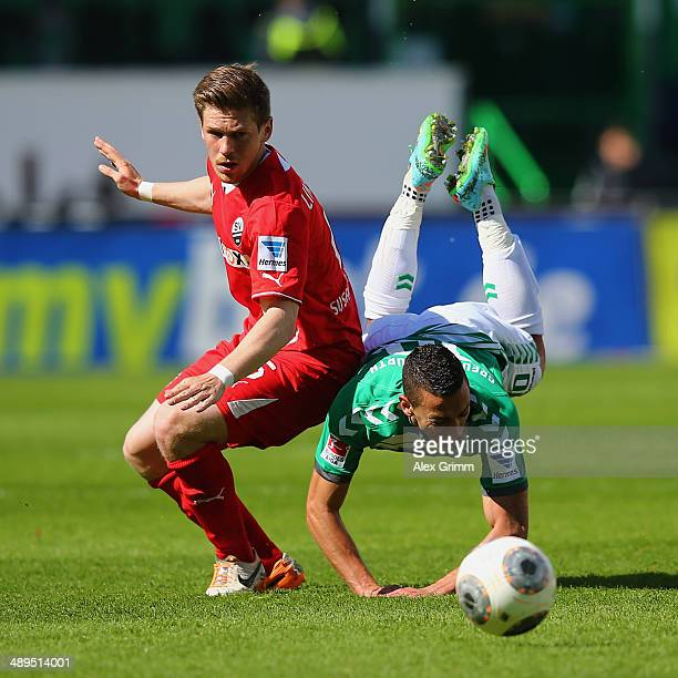 Nikola Djurdjic of Greuther Fuerth is challenged by Denis Linsmayer of Sandhausen during the Second Bundesliga match between Greuther Fuerth and SV...