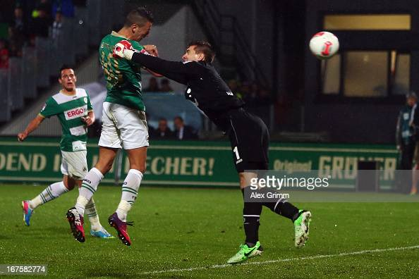Nikola Djurdjic of Greuther Fuerth scores his team's second goal against goalkeeper RonRobert Zieler of Hannover during the Bundesliga match between...