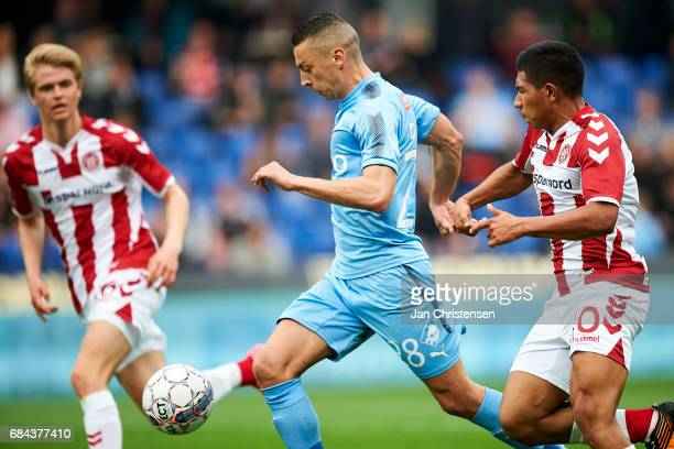 Nikola Djurdjic of Randers FC and Edison Flores of AaB Aalborg compete for the ball during the Danish Alka Superliga match between Randers FC and AaB...