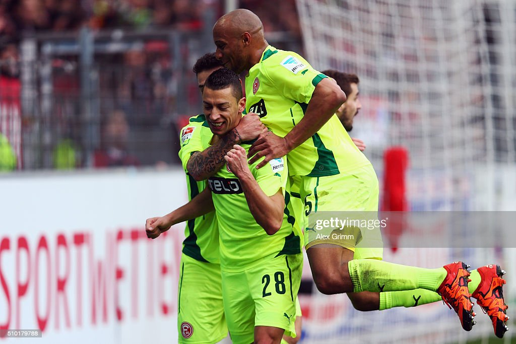 Nikola Durdic #28 of Duesseldorf celebrates his team's first goal with team mates Christopher Avevor during the Second Bundesliga match between SC Freiburg and Fortuna Duesseldorf at Schwarzwald-Stadion on February 14, 2016 in Freiburg im Breisgau, Germany.