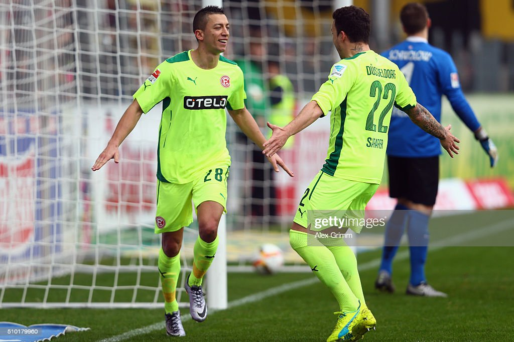 Nikola Durdic (L) of Duesseldorf celebrates his team's first goal with team mate Sercan Sararer during the Second Bundesliga match between SC Freiburg and Fortuna Duesseldorf at Schwarzwald-Stadion on February 14, 2016 in Freiburg im Breisgau, Germany.