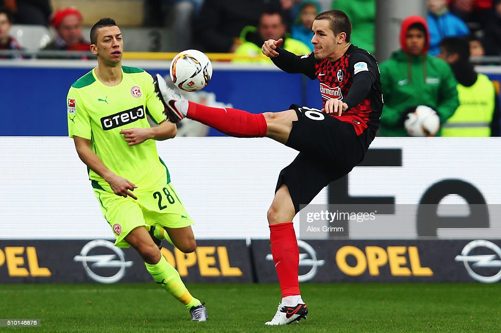 Nikola Durdic (L) of Duesseldorf is challenged by Christian Guenter of Freiburg during the Second Bundesliga match between SC Freiburg and Fortuna Duesseldorf at Schwarzwald-Stadion on February 14, 2016 in Freiburg im Breisgau, Germany.