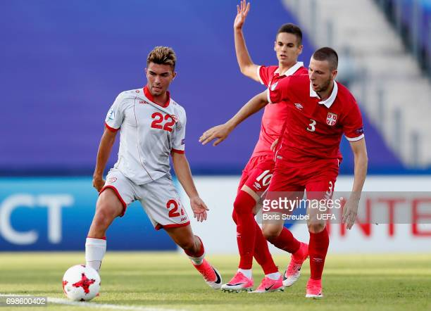 Nikola Gjorgjev of FYR Macedonia is challenged by players of Serbia during the UEFA European Under21 Championship match between Serbia and Macedonia...