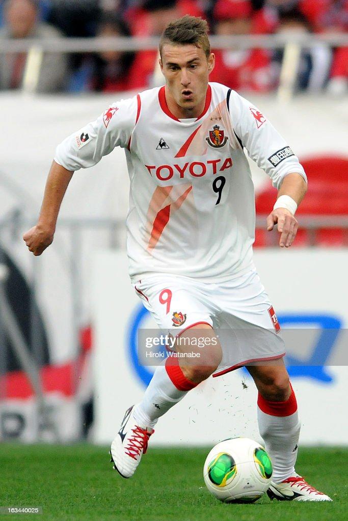 Nikola Jakimovski of Nagoya Grampus in action during the J.League match between Urawa Red Diamonds and Nagoya Grampus at Saitama Stadium on March 9, 2013 in Saitama, Japan.