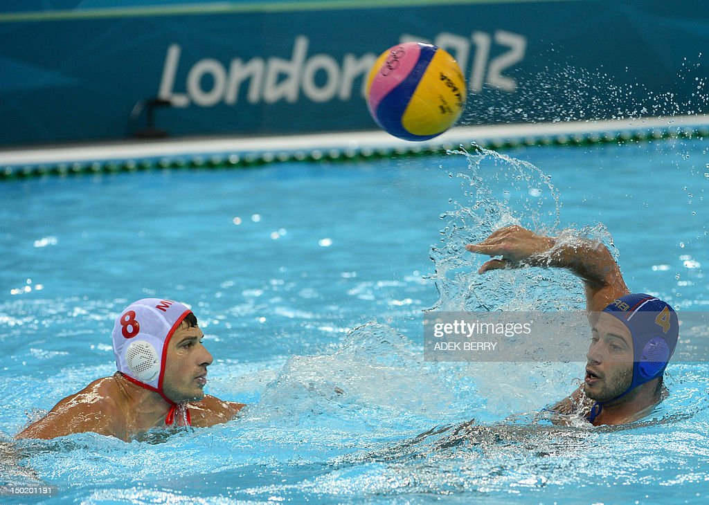 Nikola Janovic of Montenegro looks on as Vanja Udovicic of Serbia throws the ball during the men's water polo bronze medal match Montenegro vs Serbia...