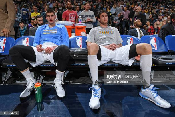 Nikola Jokic and Danilo Gallinari of the Denver Nuggets look on before the game against the Los Angeles Lakers on March 13 2017 at the Pepsi Center...