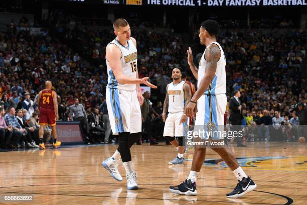 Nikola Jokic and Jamal Murray of the Denver Nuggets high five each other during the game against the Cleveland Cavaliers on March 22 2017 at the...