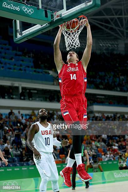 Nikola Jokic of Serbia dunks the ball ahead of Kyrie Irving of United States on Day 7 of the Rio 2016 Olympic Games at Carioca Arena 1 on August 12...