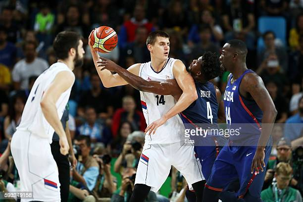 Nikola Jokic of Serbia looks to pass the ball over Jimmy Butler of United States during the Men's Gold medal game on Day 16 of the Rio 2016 Olympic...