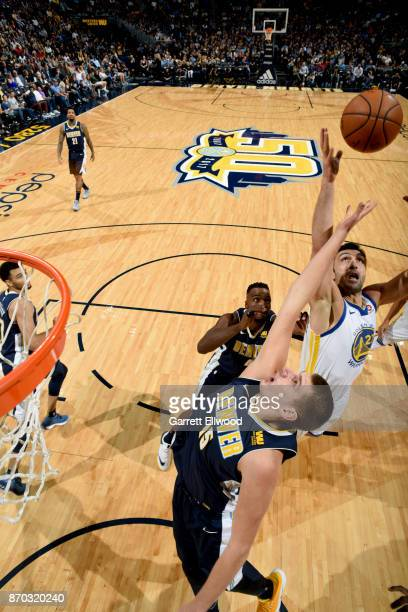 Nikola Jokic of the Denver Nuggets and Zaza Pachulia of the Golden State Warriors jump for the rebound on November 4 2017 at the Pepsi Center in...