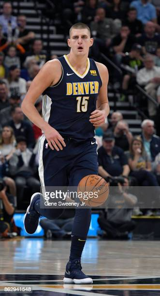 Nikola Jokic of the Denver Nuggets brings the ball up court against the against the Utah Jazz at Vivint Smart Home Arena on October 18 2017 in Salt...