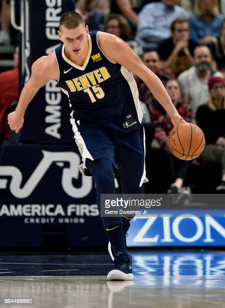 Nikola Jokic of the Denver Nuggets brings the ball up court against the Utah Jazz at Vivint Smart Home Arena on October 18 2017 in Salt Lake City...