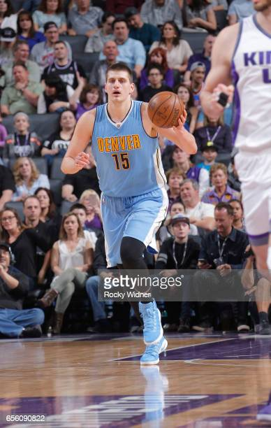 Nikola Jokic of the Denver Nuggets brings the ball up the court against the Sacramento Kings on March 11 2017 at Golden 1 Center in Sacramento...