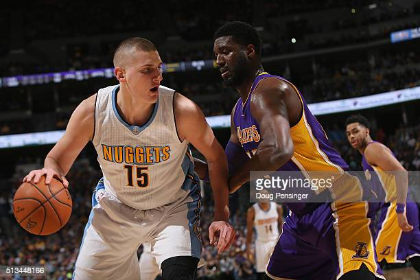 Nikola Jokic of the Denver Nuggets controls the ball against Roy Hibbert of the Los Angeles Lakers at Pepsi Center on March 2 2016 in Denver Colorado...
